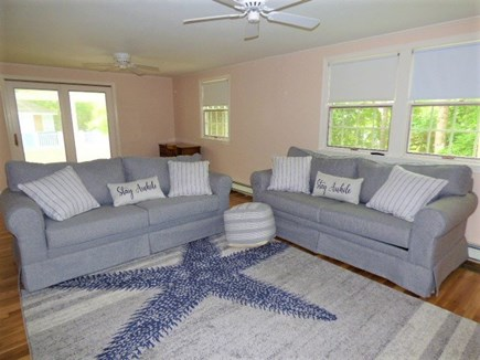 Dennis Cape Cod vacation rental - Living area with pullout sofas & enclosed sunroom leads to pool