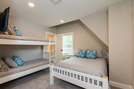 Dennis Village-Mayflower Beach Cape Cod vacation rental - Bunk room with queen bed & twin over twin bunks & full bathroom
