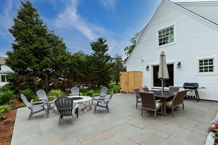 Dennis Village-Mayflower Beach Cape Cod vacation rental - Back patio with outdoor shower,table with chairs & firepit