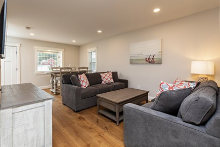 Dennis Village-Mayflower Beach Cape Cod vacation rental - Den with pull out couch, TV, and dining room table