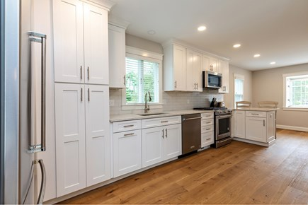 Dennis Village-Mayflower Beach Cape Cod vacation rental - Bright, spacious kitchen with 2 counter stools