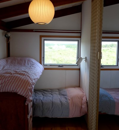 Truro Cape Cod vacation rental - Two bunkbeds on each side. Divided by accordian divider curtain.