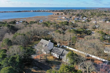West Yarmouth (Seagull Beach) Cape Cod vacation rental - Drone view of home with beach in the distance.