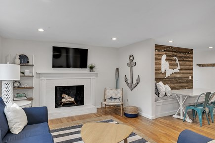 Dennis Cape Cod vacation rental - Living room with wood burning fireplace and Smart TV.