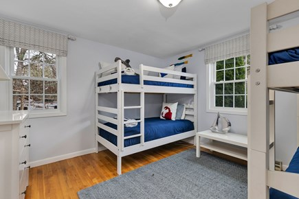 Dennis Cape Cod vacation rental - Main floor bunk room (4 twin beds) has dresser and closet.