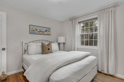 Dennis Cape Cod vacation rental - Main floor bedroom with Queen bed has dresser, mirror and closet.