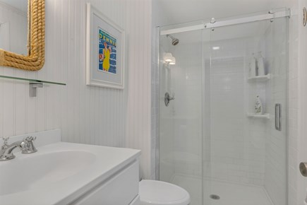 Dennis Cape Cod vacation rental - Master bathroom with walk in shower and glass door.