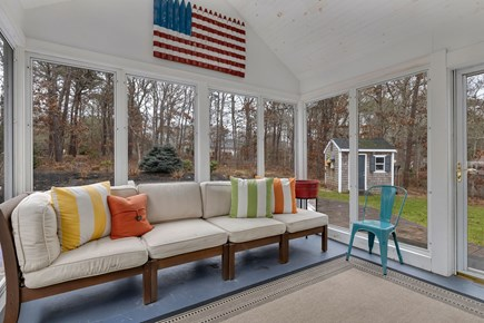 Dennis Cape Cod vacation rental - Three season room off main living area opens to the backyard.