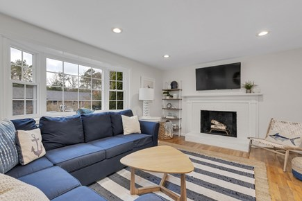 Dennis Cape Cod vacation rental - Living room with wood burning fireplace.