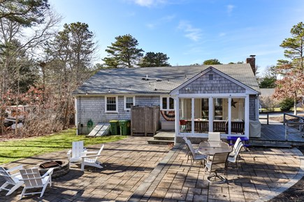 Dennis Cape Cod vacation rental - Back of house with three season room and outdoor shower.