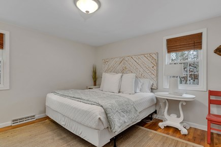 Dennis Cape Cod vacation rental - Master bedroom has King bed, en suite bathroom, TV and closet.