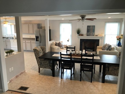 Popponesset, Mashpee Cape Cod vacation rental - Open concept kitchen w lg table for 12 & sitting area on main flr