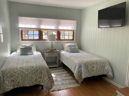 West Yarmouth Cape Cod vacation rental - 3rd Bedroom includes 2 twin beds, tv, closet & door to back yard