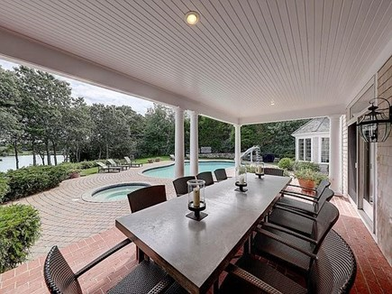 Marstons Mills, Barnstable Cape Cod vacation rental - Outdoor dining overlooking pool/patio and waterfront