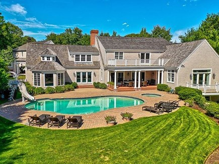 Marstons Mills, Barnstable Cape Cod vacation rental - Rear of home - pool, patio, hot tub, outdoor dining