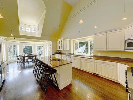 Marstons Mills, Barnstable Cape Cod vacation rental - Galley kitchen, 4-stool island, table for 8 overlooking pool/dock