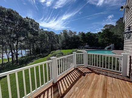 Marstons Mills, Barnstable Cape Cod vacation rental - First Floor master balcony overlooking pool, dock, and Oyster Bay