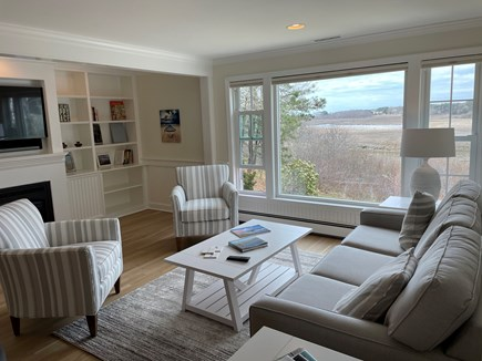 South Chatham Cape Cod vacation rental - A family room off the kitchen with TV and gas fireplace