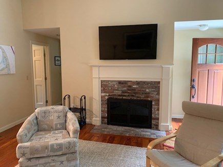 Orleans Cape Cod vacation rental - Living room with fireplace and flatscreen TV.