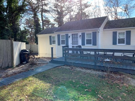 Dennisport Cape Cod vacation rental - Front of House . Wrap around private deck with outdoor shower.