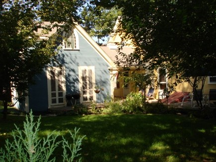 Wellfleet, Down Town Village Cape Cod vacation rental - Back of home showing carriage house