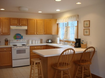 Wellfleet Cape Cod vacation rental - Kitchen with eating counter open to dining
