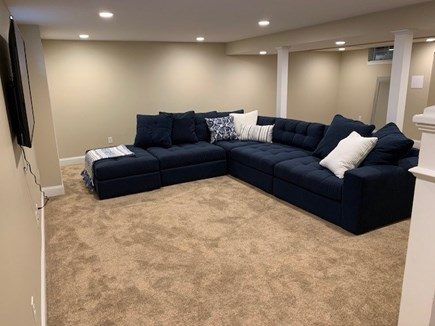 Orleans Cape Cod vacation rental - Cozy basement with huge sofa for snoozing and TV/movie time!