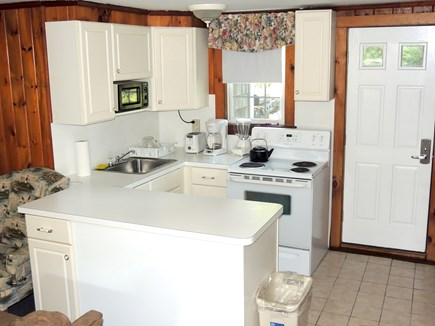 West Dennis Cape Cod vacation rental - Kitchen with door leading to back yard