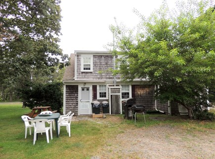 West Dennis Cape Cod vacation rental - Back yard, grill, and outdoor dining area
