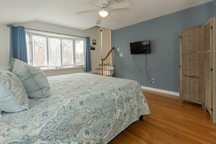 Hyannis Cape Cod vacation rental - Sunken master bedroom with king, wall mounted TV ,bow window