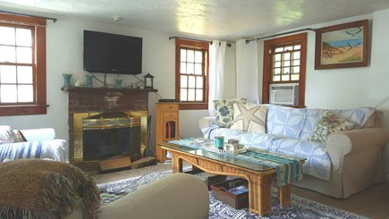 Dennisport Cape Cod vacation rental - Cozy Living Room . Expanded cable with fireplace for cool days.