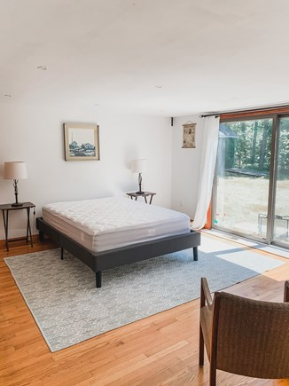 South Dennis Cape Cod vacation rental - Queen bedroom with patio through sliding doors.