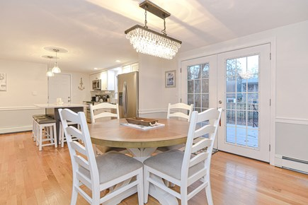 Hyannis/Centerville LIne Cape Cod vacation rental - Dining area overlooking deck and yard.