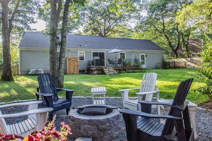 Hyannis/Centerville LIne Cape Cod vacation rental - Backyard view with firepit area.