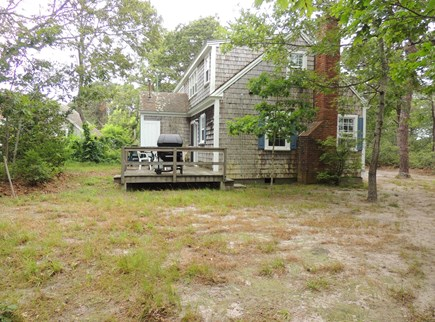 West Dennis Cape Cod vacation rental - Side yard and back porch