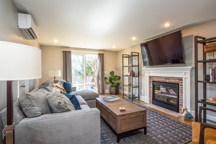 Provincetown, Cod Hollow Cape Cod vacation rental - Living room with gas fireplace and sliding doors to outdoor deck