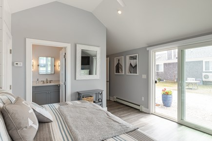Popponesset Cape Cod vacation rental - Master bedroom with master bath and sliders to patio