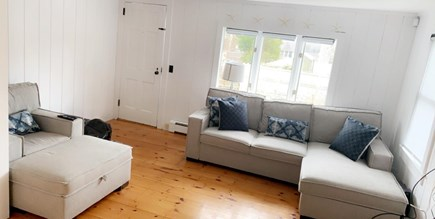 Harwich Port Cape Cod vacation rental - Cozy living room - couch pulls out to accommodate two more guests