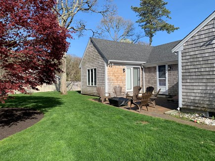 Harwich Port Cape Cod vacation rental - Beautiful back yard - fenced in with firepit