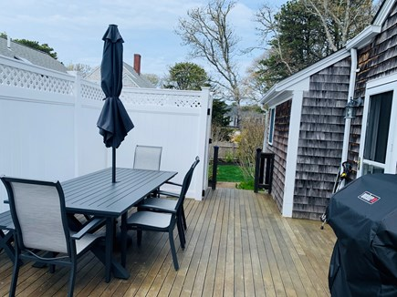 Harwich Port Cape Cod vacation rental - Side patio - full grill, eating area and outdoor shower