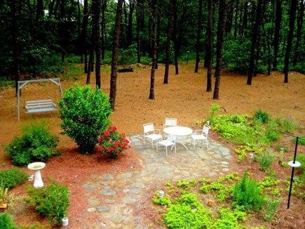 Wellfleet Cape Cod vacation rental - Peaceful backyard with additional seating area.