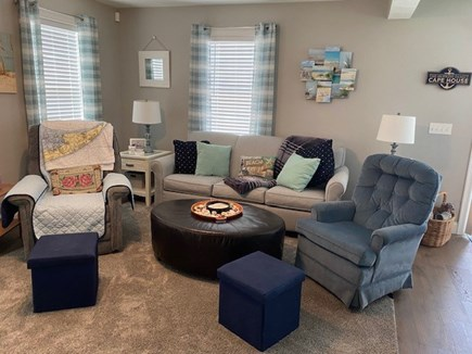 """Dennis Cape Cod vacation rental - Living room with open floor plan and 75"""" TV."""