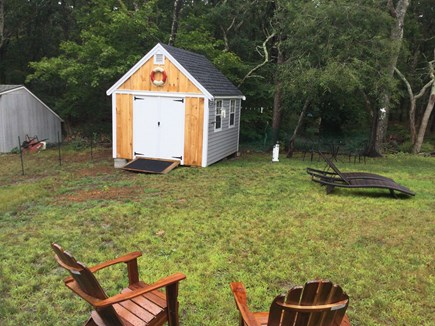 Dennis Cape Cod vacation rental - Outdoor shed with beach chairs, umbrellas, canopies and toys.
