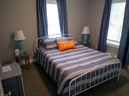Dennis Cape Cod vacation rental - Queen sized bedroom overlooking backyard.