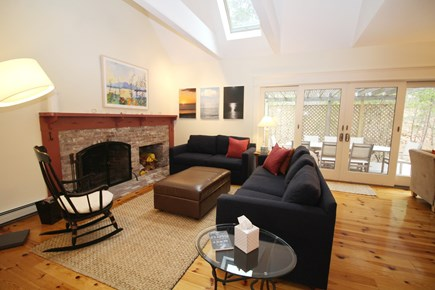 Wellfleet Cape Cod vacation rental - Living room with comfortable seating and door to deck