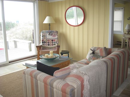 West Dennis Cape Cod vacation rental - Sitting room with slider to back deck