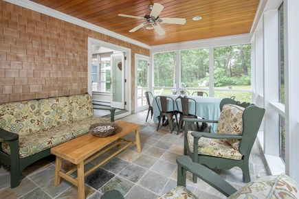 Wellfleet Cape Cod vacation rental - Enjoy family meals on the screened porch.
