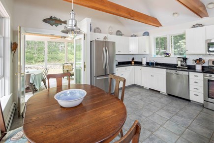 Wellfleet Cape Cod vacation rental - Large eat in kitchen opens to the porch thru double French doors.