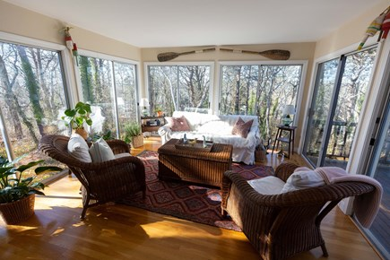 Dennis Village Cape Cod vacation rental - Comfy sunroom with great sunset views.