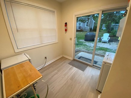 West Dennis Cape Cod vacation rental - New slider and floors in porch area facing backyard BBQ area.